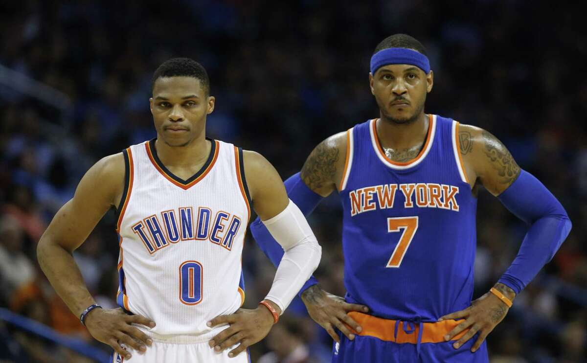 Oklahoma City Thunder guard Russell Westbrook (0) and New York Knicks forward Carmelo Anthony (7) are pictured in the first quarter of an NBA basketball game in Oklahoma City, Friday, Nov. 20, 2015. New York won 93-90. (AP Photo/Sue Ogrocki)