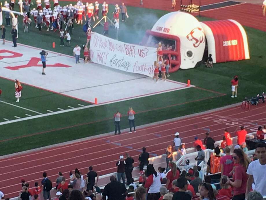 The Crosby Cougar football team prepares to come out of the tunnel before their game against the Porter Spartans at home on Friday night Photo: Elliott Lapin