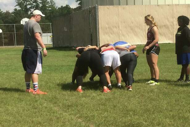 Participants at the Kingwood Girls Rugby Club clinic practice a scrum