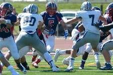 Brien McMahon #5 Leandro Martin runs the ball as the Staples High School football team take on  Brien McMahon High School  Saturday, September 23, 2017, in Norwalk, Conn.
