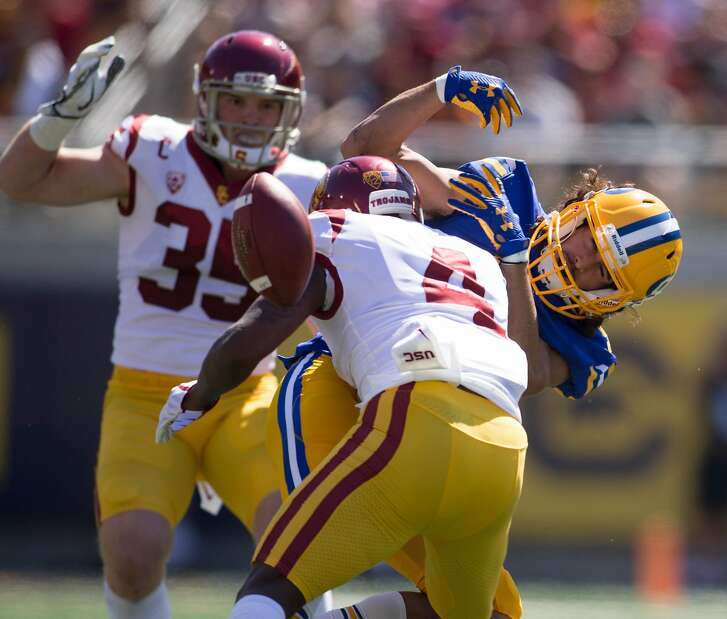 California�s Kanawai Noa (9) can't hold onto a pass as he's hit by Southern California�s Chris Hawkins (4) during the second quarter of a NCAA football game, on Saturday, Sept. 23, 2017 in Berkeley, Calif.