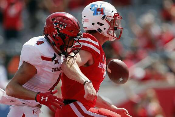Houston Cougars quarterback Kyle Postma (3) rushes for a touchdown in the fourth quarter past Texas Tech Red Raiders defensive back Desmon Smith (4) during the NCAA football game between the Texas Tech Red Raiders and the Houston Cougars at TDECU Stadium in Houston, TX on Saturday, September 23, 2017.
