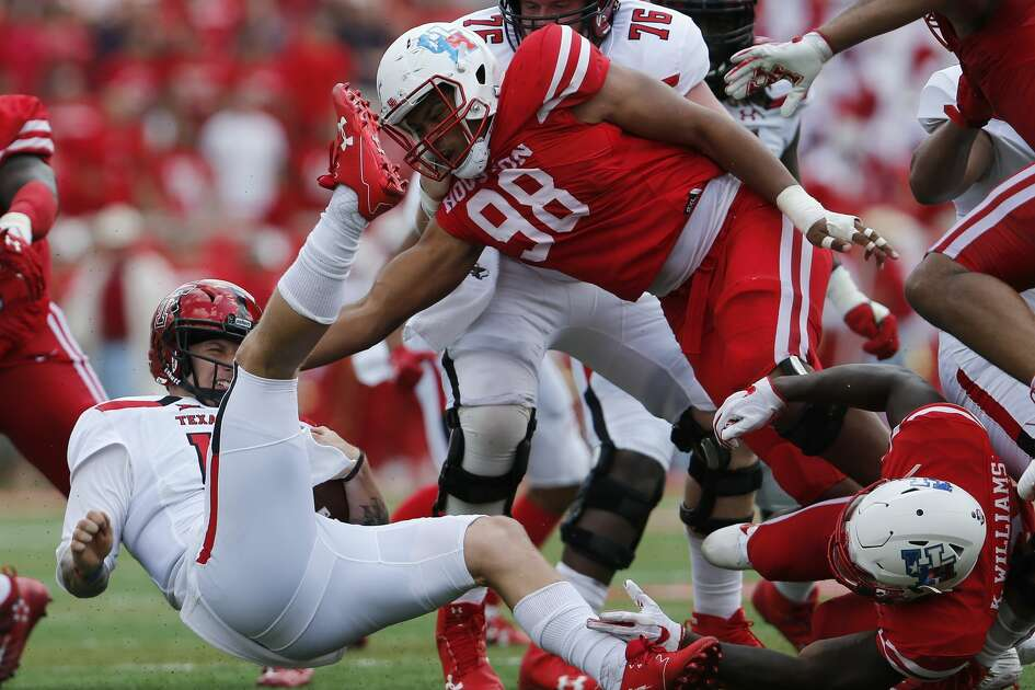 Texas Tech Red Raiders quarterback Nic Shimonek (16) is sacked by Houston Cougars safety Khalil Williams (2) and defensive lineman Payton Turner (98) in the second quarter during the NCAA football game between the Texas Tech Red Raiders and the Houston Cougars at TDECU Stadium in Houston, TX on Saturday, September 23, 2017.