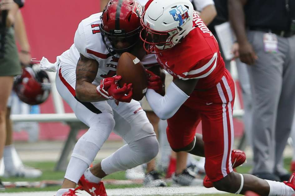 Houston Cougars cornerback Isaiah Johnson (14) breaks up a pass intended for Texas Tech Red Raiders wide receiver Derrick Willies (11) in the second quarter during the NCAA football game between the Texas Tech Red Raiders and the Houston Cougars at TDECU Stadium in Houston, TX on Saturday, September 23, 2017.