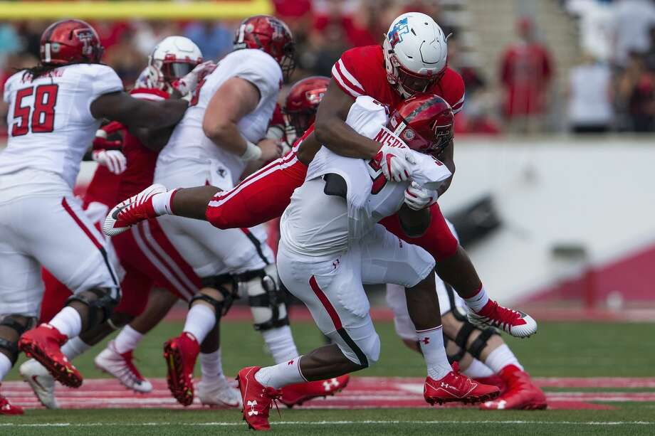 Houston Cougars defensive tackle Ed Oliver (10) tackles Texas Tech Red Raiders running back Desmond Nisby (32) for a loss in the first quarter during the NCAA football game between the Texas Tech Red Raiders and the Houston Cougars at TDECU Stadium in Houston, TX on Saturday, September 23, 2017. Photo: Tim Warner/For The Chronicle
