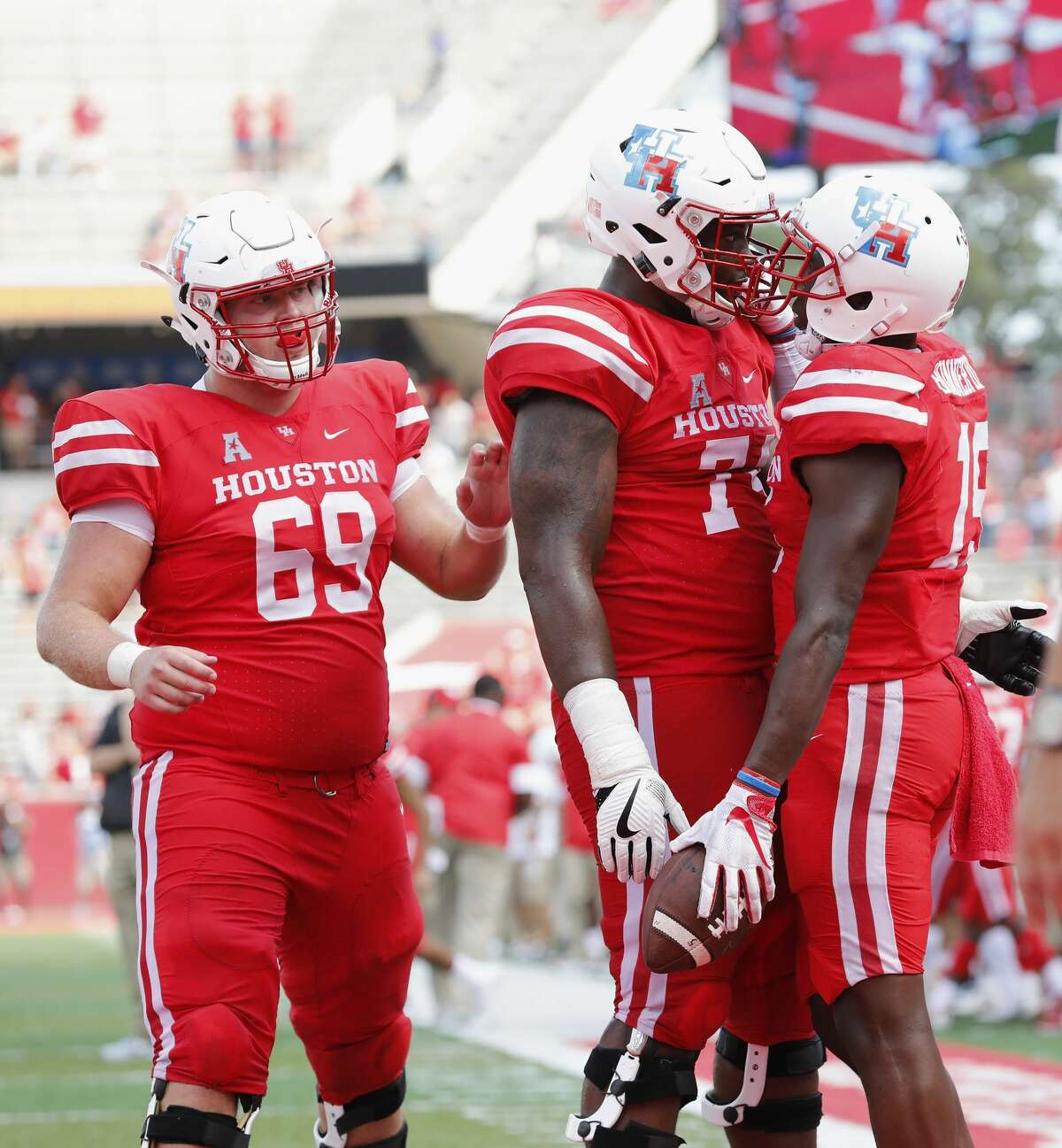 Houston Cougars offensive lineman Josh Jones (74) and offensive lineman Will Noble (69) celebrate with wide receiver Linell Bonner (15) after a touchdown in the fourth quarter during the NCAA football game between the Texas Tech Red Raiders and the Houston Cougars at TDECU Stadium in Houston, TX on Saturday, September 23, 2017.