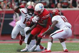 Houston Cougars wide receiver Steven Dunbar (88) is tackled by Texas Tech Red Raiders defensive back Jaylon Lane (28) and linebacker Riko Jeffers (11) in the third quarter during the NCAA football game between the Texas Tech Red Raiders and the Houston Cougars at TDECU Stadium in Houston, TX on Saturday, September 23, 2017.