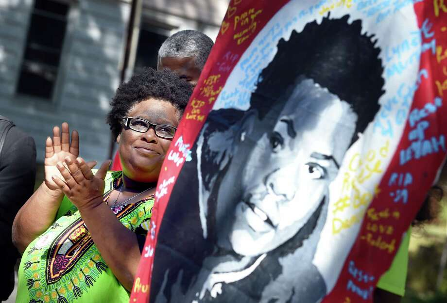 Demethra Telford talks about her son, Tyriek Keyes (poster at right), who was shot and killed two months ago during an anti-violence neighborhood march with the theme, Jobs For Youth, Jobs For All, in the Newhallville section of New Haven on September 23, 2017. Arnold Gold / Hearst Connecticut Media Photo: Arnold Gold, Hearst Connecticut Media / New Haven Register