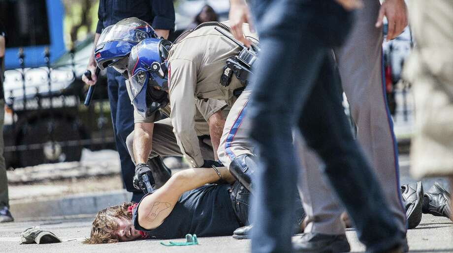 Protestor Andrew Alemao is restrained on the pavement after a scuffle broke out during a rally against Confederate monuments at the Capitol in Austin, Texas on September 23, 2017. Photo: Thao Nguyen / / Thao Nguyen