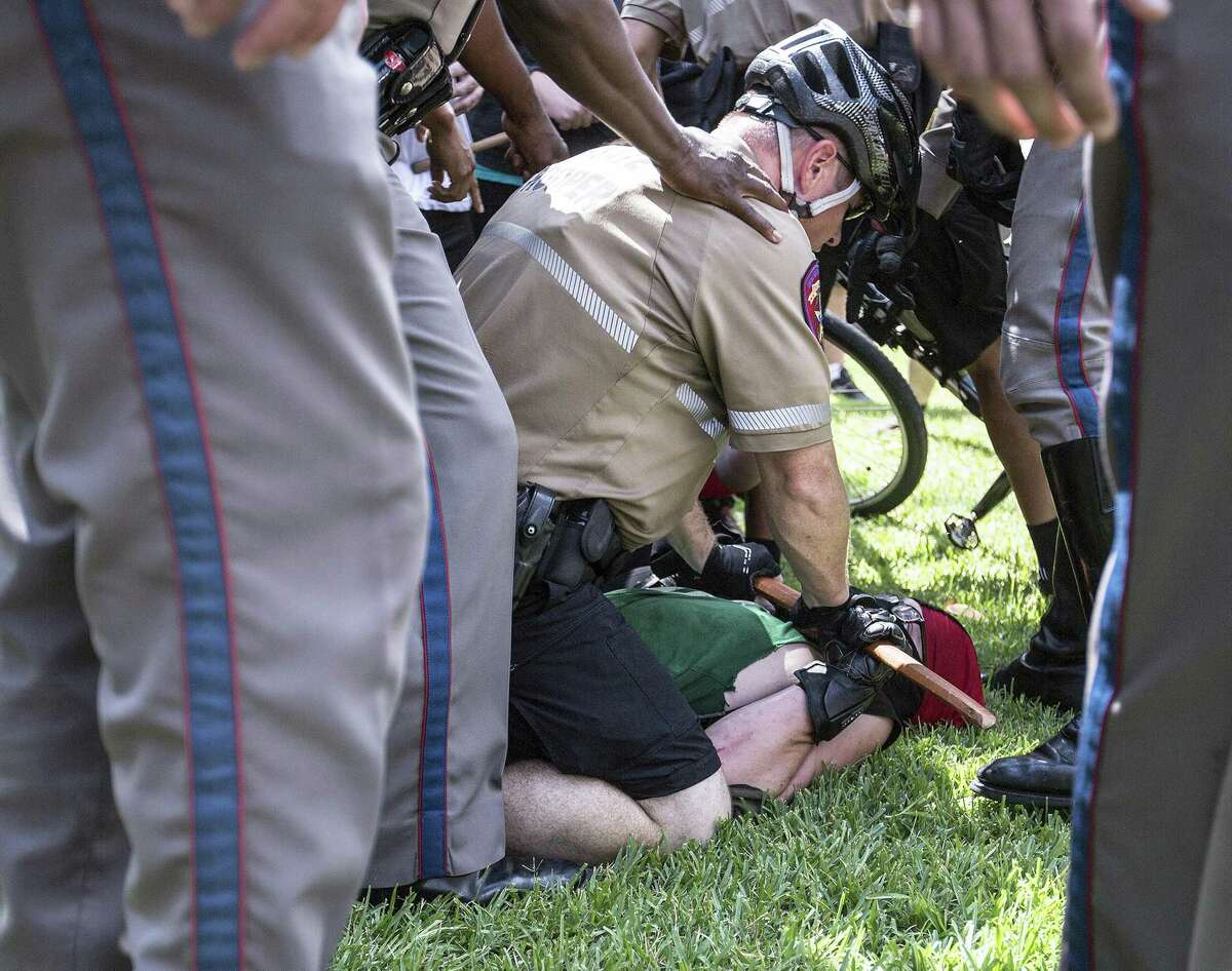 An Antifa international member is being held down by law enforcement after a scuffle between Antifa and another counter protester at the Capitol in Austin, Texas on September 23, 2017.