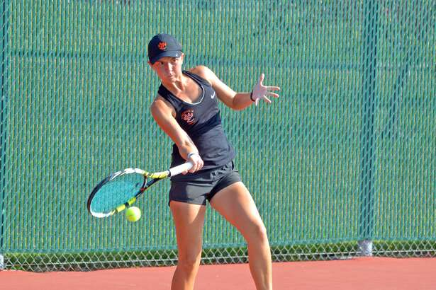 Edwardsville senior Grace Desse makes a forehand return during her No. 2 singles match against Columbia (Mo.) Rock Bridge on Saturday during the Southern Illinois Duals at the EHS  Tennis Center.