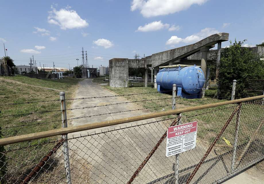 A gate at the U.S. Oil Recovery Superfund site is shown Thursday, Sept. 14, 2017, in Pasadena, Texas, where three tanks once used to store toxic waste were flooded during Hurricane Harvey. The Environmental Protection Agency says it has found no evidence that toxins washed off the site, but is still assessing damage.  (AP Photo) Photo: AP