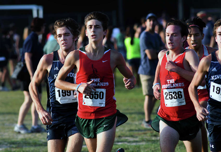 Kingwood's Carter Storm, from left, and The Woodlands' Gavin Hoffpauir and Daniel Baker compete for the lead off the starting line during the Varsity Boys 5K race at the Andy Wells Invitational at Atascocita High School on Sept. 16, 2017. (Photo by Jerry Baker) Photo: Jerry Baker, Freelance / Freelance