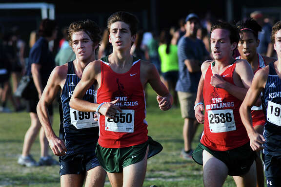 Kingwood's Carter Storm, from left, and The Woodlands' Gavin Hoffpauir and Daniel Baker compete for the lead off the starting line during the Varsity Boys 5K race at the Andy Wells Invitational at Atascocita High School on Sept. 16, 2017. (Photo by Jerry Baker)