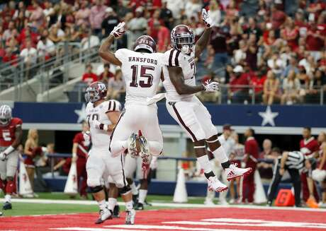Texas A&M's Aaron Hansford (15) and running back Keith Ford, right, celebrate a touchdown scored on a running play by Ford in the second half of an NCAA college football game against Arkansas on Saturday, Sept. 23, 2017, in Arlington, Texas. (AP Photo/Tony Gutierrez)