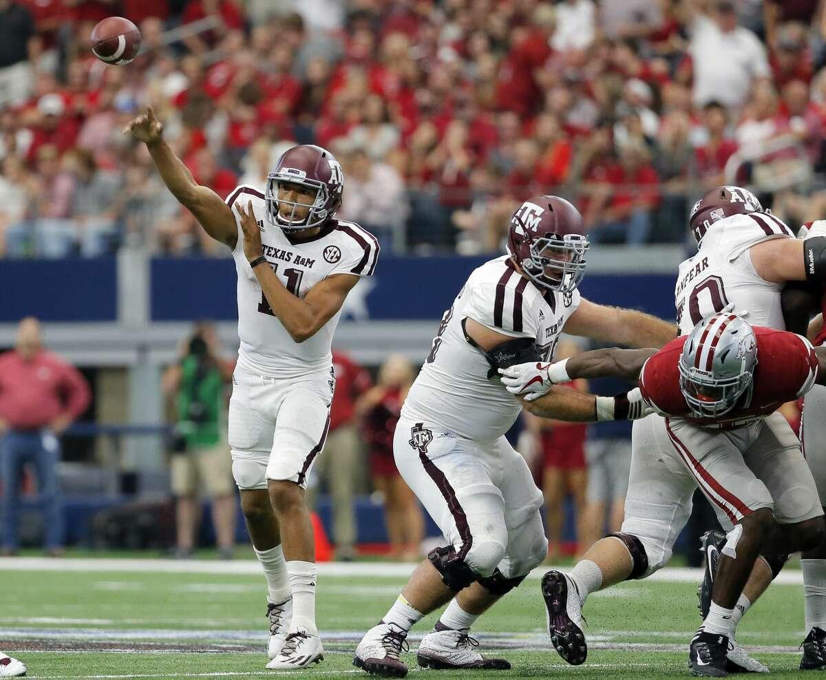Texas A&M quarterback Kellen Mond (11) throws a pass in the second half of an NCAA college football game against Arkansas on Saturday, Sept. 23, 2017, in Arlington, Texas. (AP Photo/Tony Gutierrez)