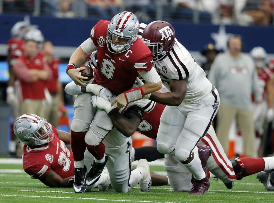 Arkansas quarterback Austin Allen (8) is sacked late in the second half of an NCAA college football game by Texas A&M linebacker Otaro Alaka, rear, and defensive lineman Landis Durham, right, Saturday, Sept. 23, 2017, in Arlington, Texas. (AP Photo/Tony Gutierrez) Photo: Tony Gutierrez/Associated Press