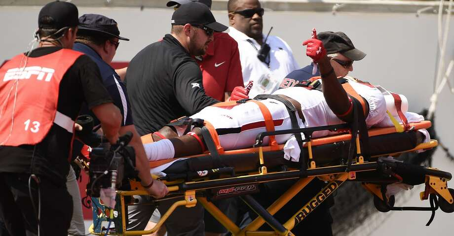PHOTOS: Texas Tech 27, UH 24Texas Tech defensive back Vaughnte Dorsey gives a thumbs-up to the crowd while being carted off the field after sustaining an injury during the second half of an NCAA college football game against Houston, Saturday, Sept. 23, 2017, in Houston. Texas Tech won 27-24. (AP Photo/Eric Christian Smith)Browse through the photos to see action from UH's loss to Texas Tech on Saturday. Photo: Eric Christian Smith/Associated Press