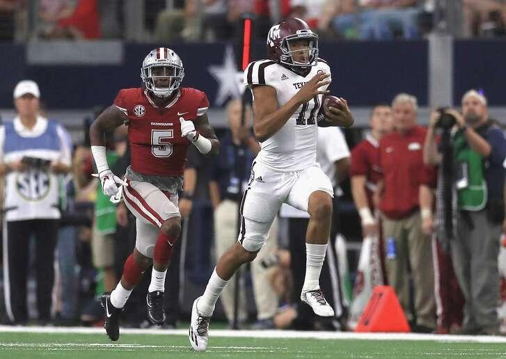 A&M freshman quarterback Kellen Mond breaks off a 79-yard run in the second quarter against Arkansas.
