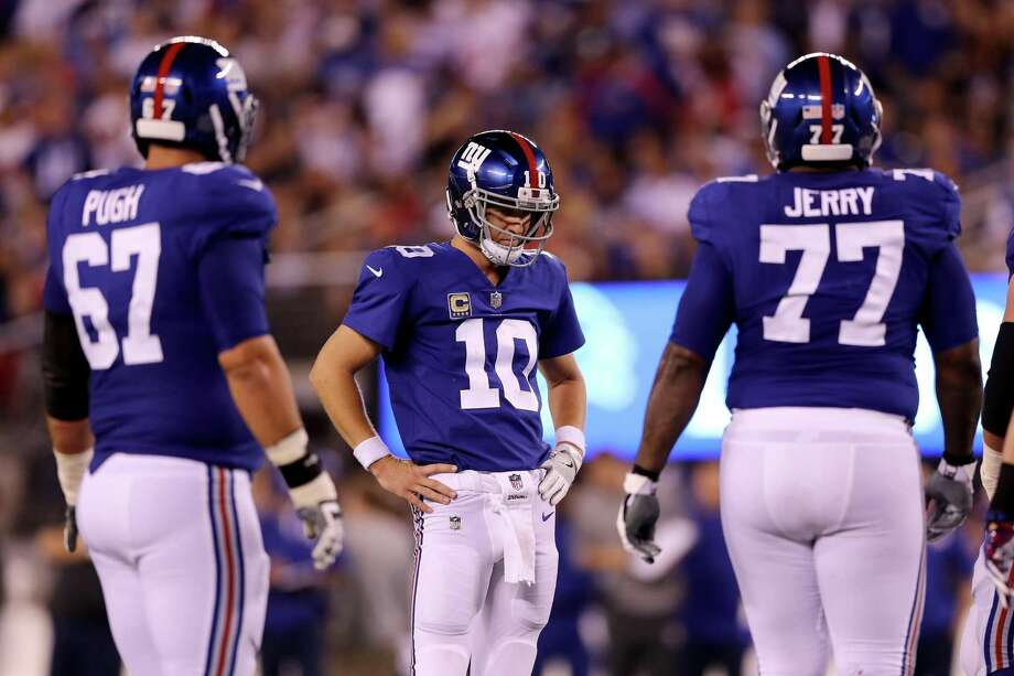Eli Manning, center, looks on during the fourth quarter of their loss to the Lions on Monday night. Photo: Getty Images / 2017 Getty Images