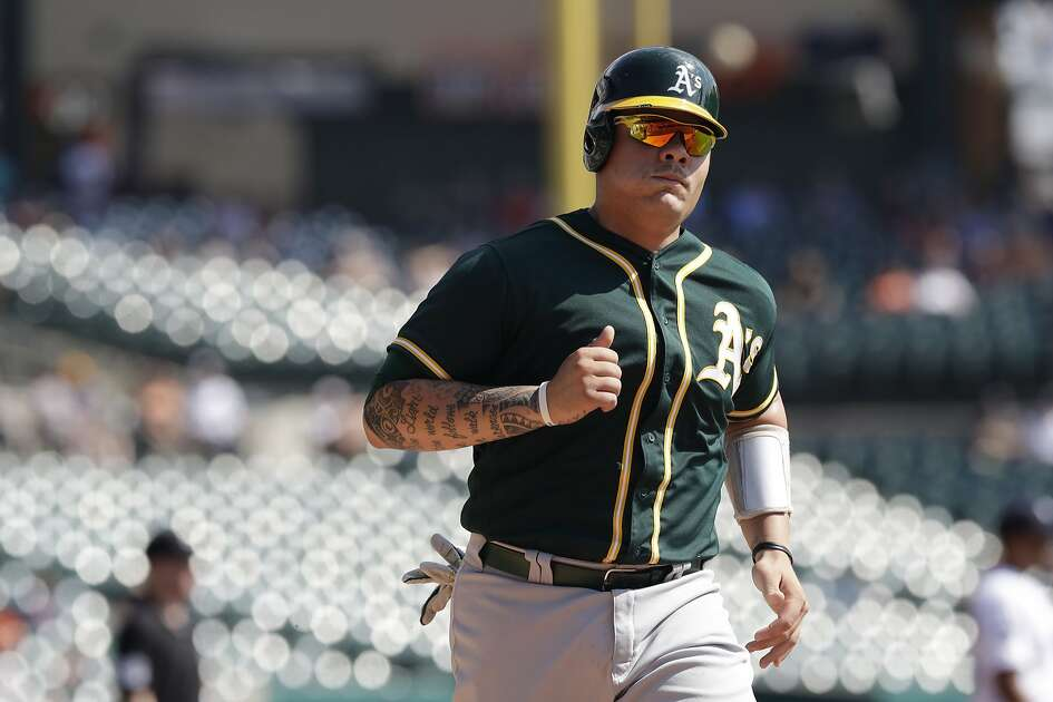 Oakland Athletics' Bruce Maxwell scores during the third inning of a baseball game against the Detroit Tigers, Wednesday, Sept. 20, 2017, in Detroit. (AP Photo/Carlos Osorio)