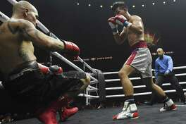 Kendo Castaneda of San Antonio knocks down Joe Sambrano of Jourdanton during their welterweight fight in the World Boxing Super Series event in the Alamodome on Saturday, Sept. 23, 2017.