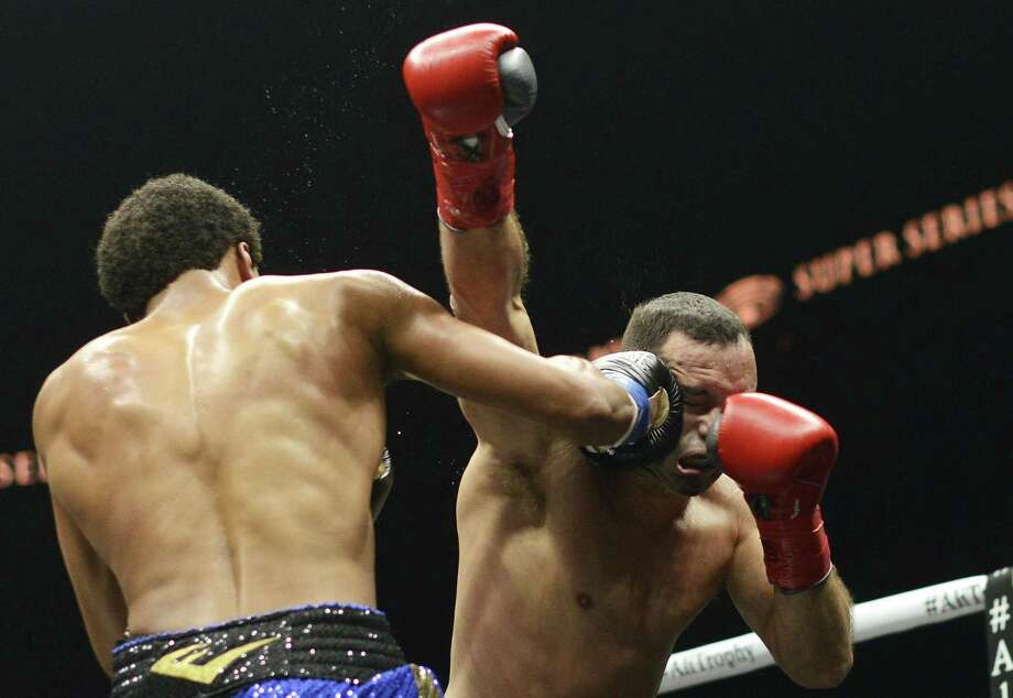 Money Powell lands a shot to the head of Reynaldo Trujillo during their super welterweights bout in the World Boxing Super Series event in the Alamodome on Saturday, Sept. 23, 2017. Photo: Billy Calzada, Staff / San Antonio Express-News / San Antonio Express-News