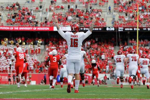 Texas Tech quarterback Nic Shimonek (16) celebrates after a touchdown run by running back Justin Stockton  against Houston in the fourth quarter Saturday.