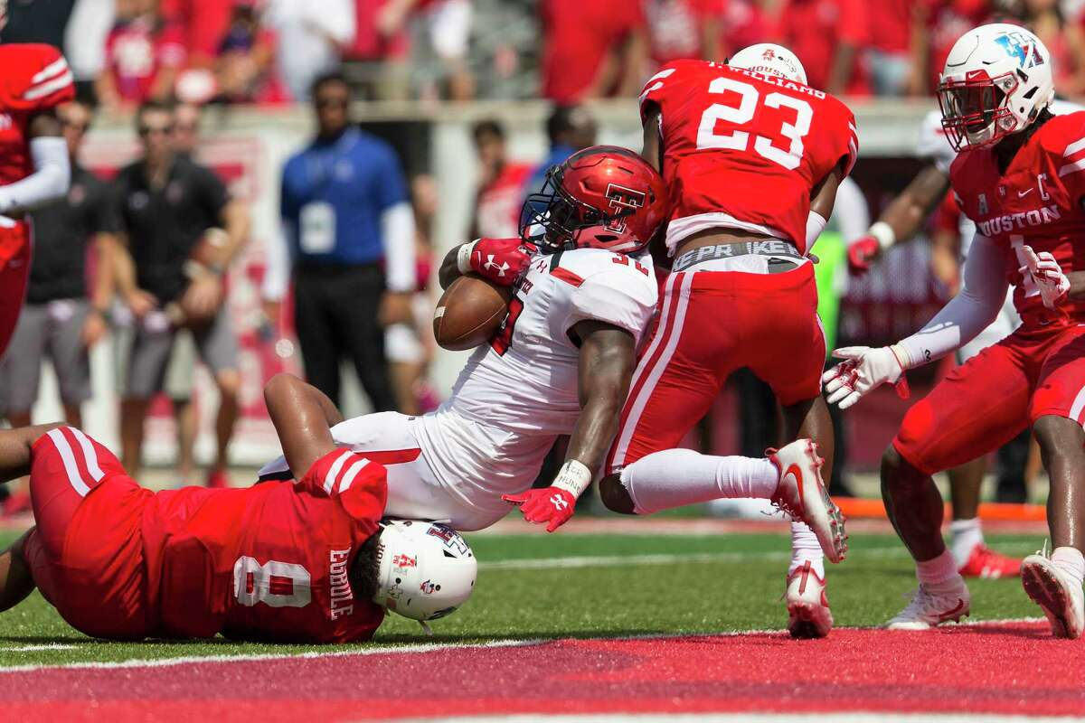 Red Raiders running back Desmond Nisby (32) gets into the end zone as UH safety Terrell Williams (23) tries to stop him in the second quarter Saturday at TDECU Stadium.