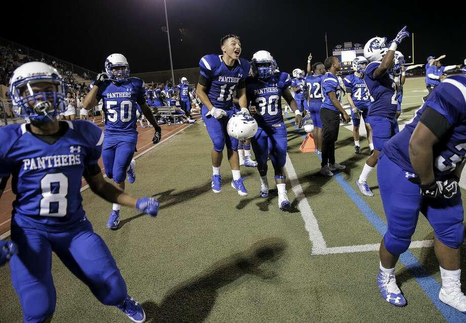 Members of C.E.King High School's football team, including Jose Sanchez (11) celebrates on the sidelines during the team's win over Willis on Friday, Sept. 22, 2017, in Houston. ( Elizabeth Conley / Houston Chronicle ) Photo: Elizabeth Conley/Houston Chronicle