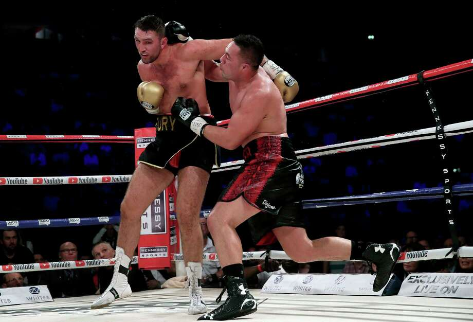 New Zealand's Joseph Parker, right, battles Britain's Hughie Fury during their WBO heavyweight title bout Saturday at Manchester, England. Photo: Nick Potts, SUB / PA Wire