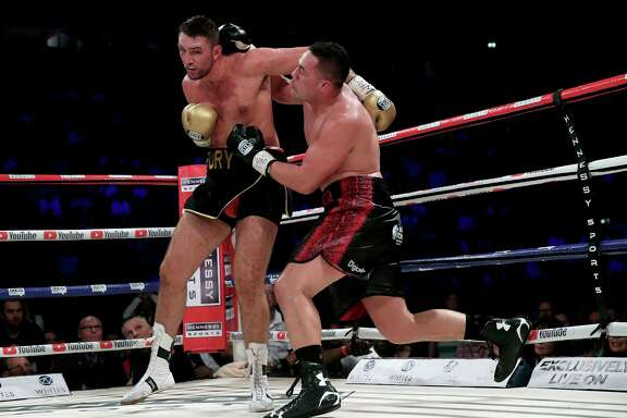 New Zealand's Joseph Parker, right, battles Britain's Hughie Fury during their WBO heavyweight title bout Saturday at Manchester, England.