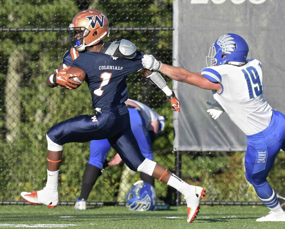 Western Connecticut's Jawad Chisholm (1) takes a pass and runs out of the grasp of Salve Regina's Connor Russo for a touchdown Saturday afternoon in Danbury. The Colonials rallied for 37-23 win to improve to 3-0. Photo: H John Voorhees III / Hearst Connecticut Media / The News-Times