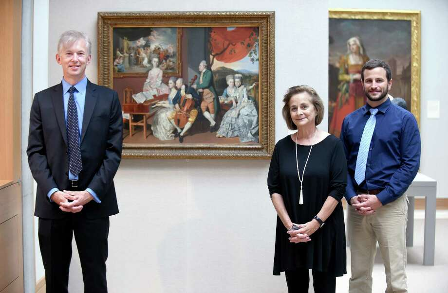 Left to right, Dr. Rob Goodman, interim chairman of radiology and biomedical imaging at the Yale School of Medicine, Linda Friedlaender, senior curator of education at the Yale Center for British Art, and Joseph Cavallo, chief resident in diagnostic radiology, are photographed in front of an 18th-century painting by Johan Joseph Zoffany at the Yale Center for British Art in New Haven. Photo: Arnold Gold / Hearst Connecticut Media / New Haven Register