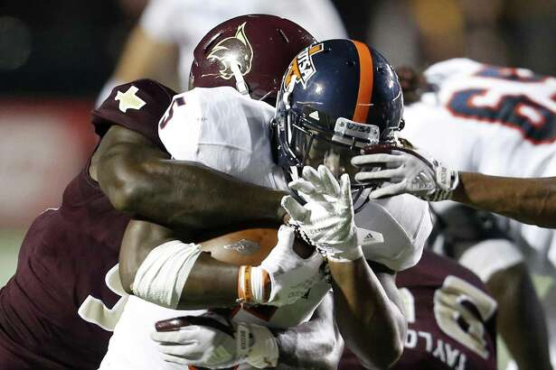 UTSA Roadrunners running back Jalen Rhodes (5) looks for room around Texas State Bobcats defenders during first half action on Sept. 23, 2017, at Bobcat Stadium in San Marcos.