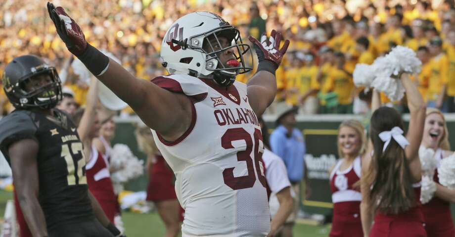 Oklahoma fullback Dimitri Flowers (36) celebrates scorong a touchdown against Baylor safety Davion Hall (12) during the first half of an NCAA college football game in Waco, Texas, Saturday, Sept. 23, 2017. (AP Photo/LM Otero) Photo: LM Otero/Associated Press