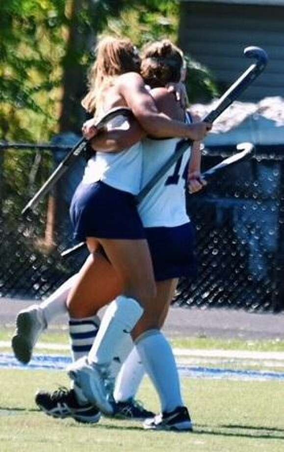 Sisters Emma and Madison Halas celebrate the winning goal in the Immaculate High School field hockey team's overtime victory over Suffield on Sept 23. at Immaculate High School in Danbury. Emma scored the winning goal off an assist from Madison. Photo: Contributed Photo / Contributed Photo