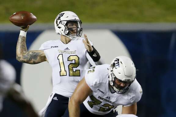HOUSTON, TX - SEPTEMBER 23:  Alex McGough #12 of the FIU Golden Panthers throws a pass in the third quarter against the Rice Owls at Rice Stadium on September 23, 2017 in Houston, Texas.  (Photo by Tim Warner/Getty Images)