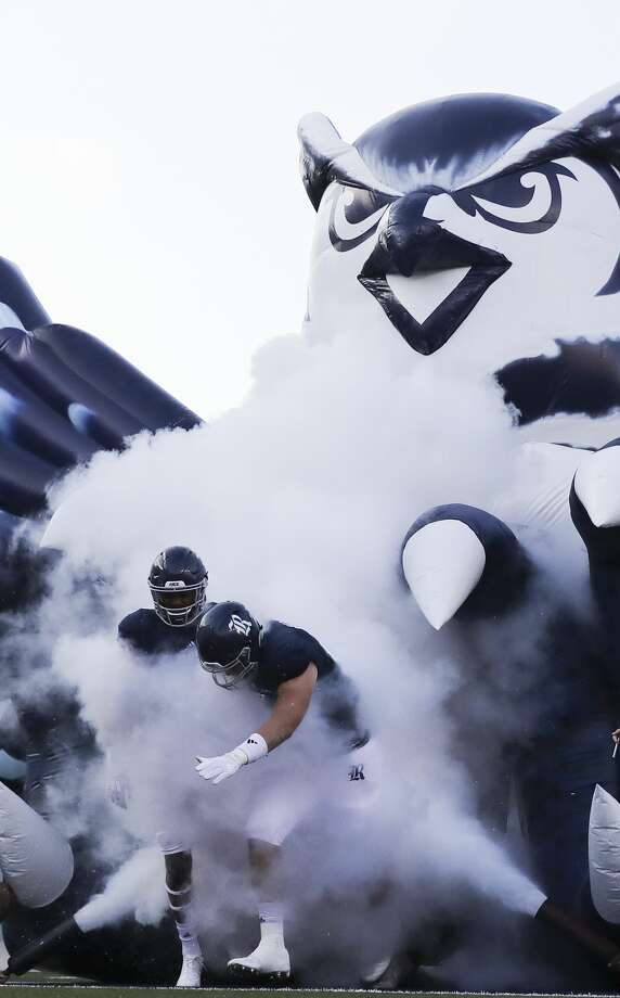 Rice University football players make their way out to the field during the opening ceremonies of game against  FIU at Rice Stadium on Saturday, Sept. 23, 2017, in Houston. ( Elizabeth Conley / Houston Chronicle ) Photo: Elizabeth Conley/Houston Chronicle
