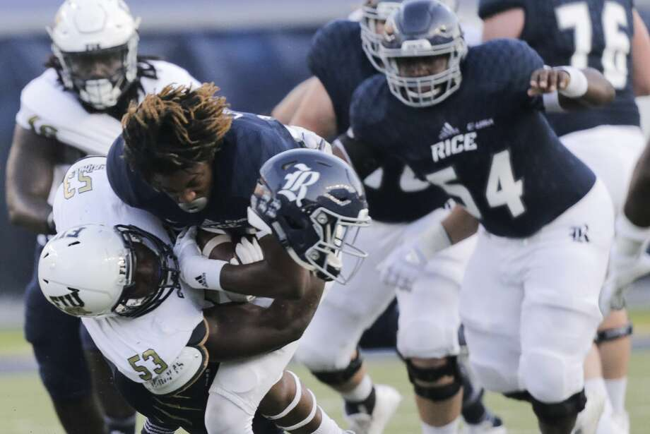 Rice Owls wide receiver Cameron Montgomery (8) while being taken down by FIU Golden Panthers linebacker Anthony Wint (53) at Rice Stadium on Saturday, Sept. 23, 2017, in Houston. ( Elizabeth Conley / Houston Chronicle ) Photo: Elizabeth Conley/Houston Chronicle