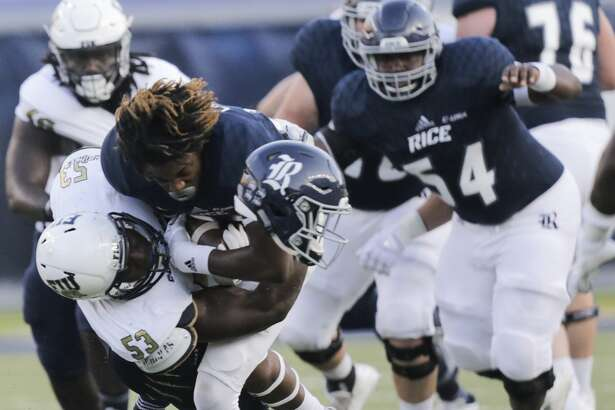 Rice Owls wide receiver Cameron Montgomery (8) while being taken down by FIU Golden Panthers linebacker Anthony Wint (53) at Rice Stadium on Saturday, Sept. 23, 2017, in Houston. ( Elizabeth Conley / Houston Chronicle )