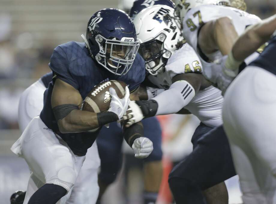 Rice running back Samuel Stewart (45) runs with the ball agianst FIU Golden Panthers  at Rice Stadium on Saturday, Sept. 23, 2017, in Houston. FIU Golden Panthers won the game 13-7.  ( Elizabeth Conley / Houston Chronicle ) Photo: Elizabeth Conley/Houston Chronicle