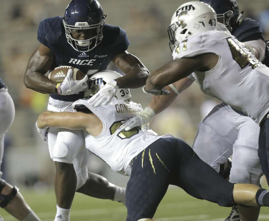 Rice Owls running back Emmanuel Esukpa (33) runs with the ball against FIU Golden Panthers at Rice Stadium on Saturday, Sept. 23, 2017, in Houston. FIU Golden Panthers won the game 13-7.  ( Elizabeth Conley / Houston Chronicle ) Photo: Elizabeth Conley/Houston Chronicle