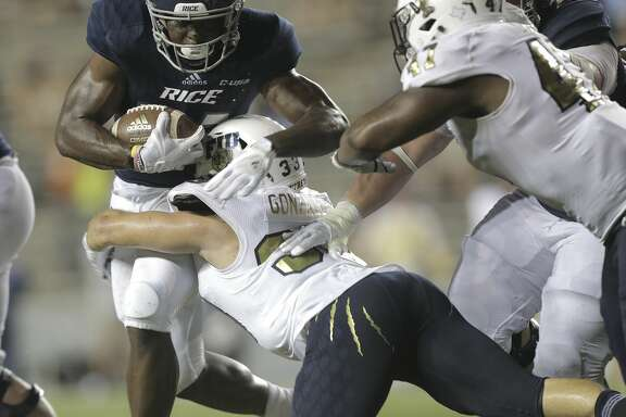 Rice Owls running back Emmanuel Esukpa (33) runs with the ball against FIU Golden Panthers at Rice Stadium on Saturday, Sept. 23, 2017, in Houston. FIU Golden Panthers won the game 13-7.  ( Elizabeth Conley / Houston Chronicle )