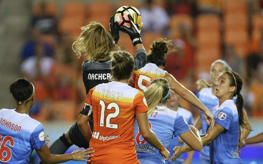 Chicago Red Stars goalkeeper Alyssa Naeher (1) beats Houston Dash defender Cari Roccaro (5) for the Dash's corner ball during the first half of the game at BBVA Compass Stadium Saturday, Sept. 23, 2017, in Houston. ( Yi-Chin Lee / Houston Chronicle ) Photo: Yi-Chin Lee, Staff / © 2017  Houston Chronicle