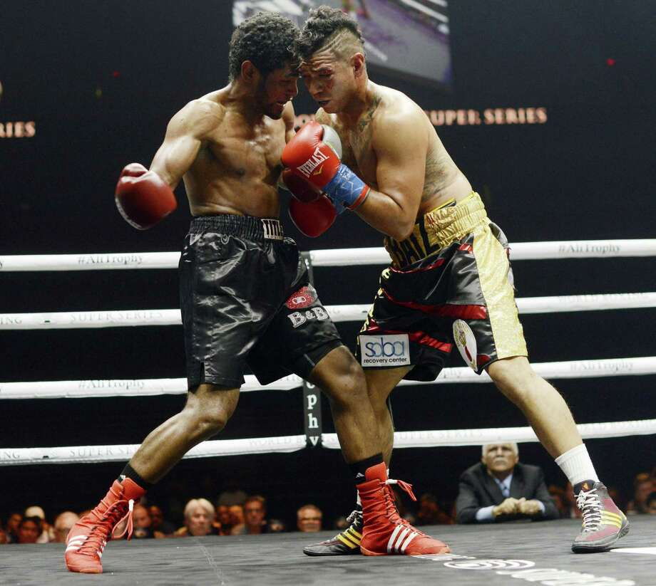 Daniel Baiz, right, of San Antonio, fights Yunier Calzada during a super welterweight match in the World Boxing Super Series event in the Alamodome on Saturday, Sept. 23, 2017. Photo: Billy Calzada, Staff / San Antonio Express-News / San Antonio Express-News