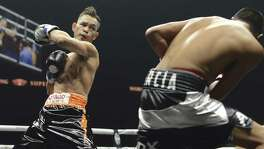 Nonito Donaire (left) battles Ruben Garcia Hernandez enroute to the WBC silver featherweight title during the World Boxing Super Series event at the Alamodome's Illusions Theater on Sept. 23, 2017. Donaire won the bout and the title.