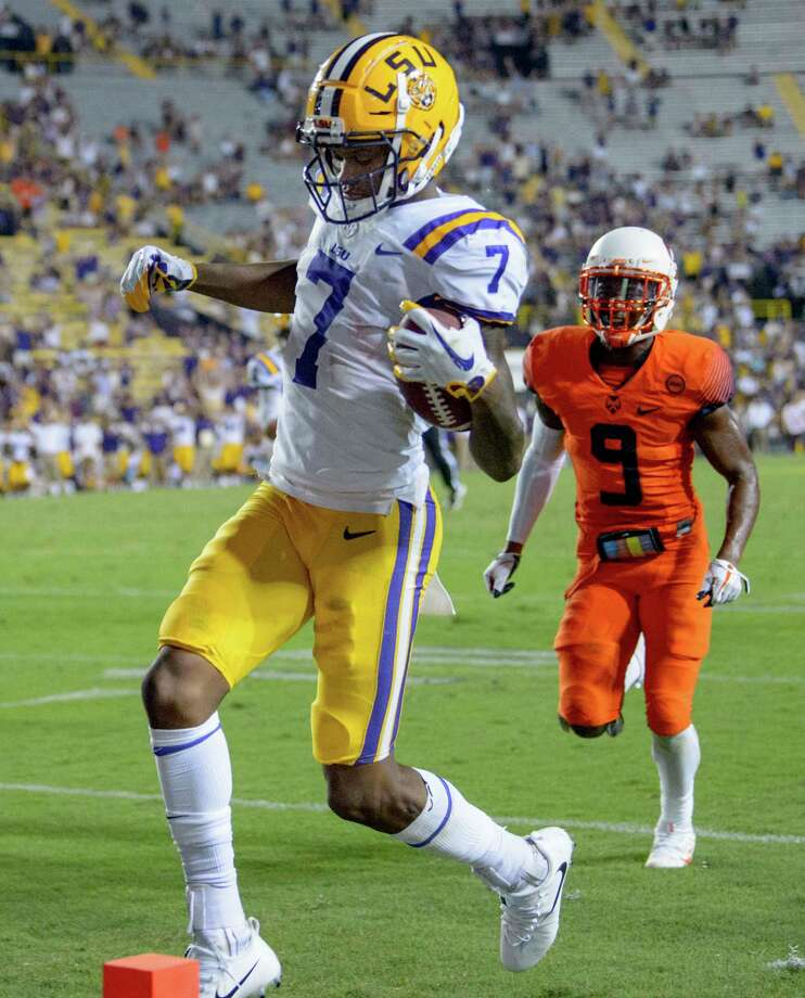 LSU wide receiver D.J. Chark (7) scores the deciding touchdown in LSU's 35-26 victory against Syracuse during an NCAA college football game in Baton Rouge, La., Saturday, Sept. 23, 2017. (AP Photo/Matthew Hinton) ORG XMIT: LAMH124 Photo: Matthew Hinton / © 2017 MATTHEW HINTON