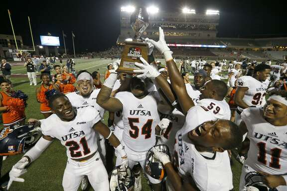 Members of the UTSA Roadrunners celebrate with the HEB I-35 Showdown Trophy after the game against the Texas State Bobcats Saturday Sept. 23, 2017 at Bobcat Stadium in San Marcos, Tx. The UTSA Roadrunners won 44-14.