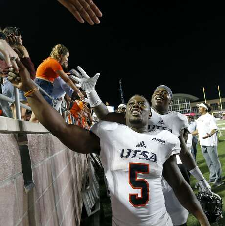 UTSA Roadrunners running back Jalen Rhodes (5), left, and defensive tackle Kevin Strong Jr. (54) celebrate with fans after the game against the Texas State Bobcats Saturday Sept. 23, 2017 at Bobcat Stadium in San Marcos, Tx. The UTSA Roadrunners won 44-14. Photo: Edward A. Ornelas, Staff / San Antonio Express-News / © 2017 San Antonio Express-News
